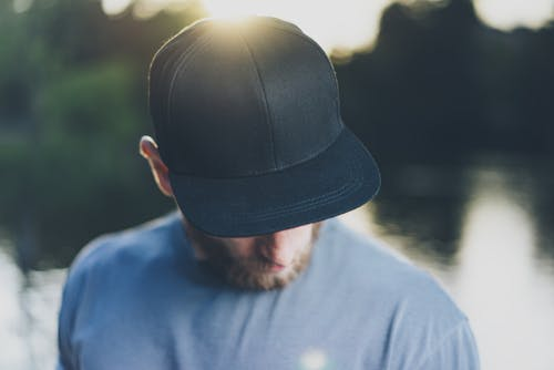 Image of a bearded man wearing a baseball cap