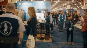 Attendees at Craft Brewers Conference visit the Kinnek booth