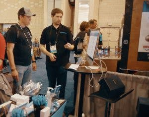 Product Manager Allen shows a customer around the Kinnek website