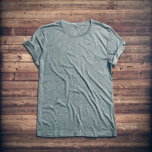 Picture of a gray t-shirt on a wood background