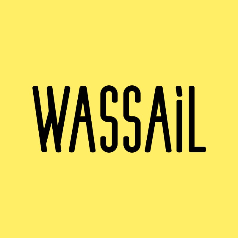 Image of the Wassail logo, with black text on a yellow background