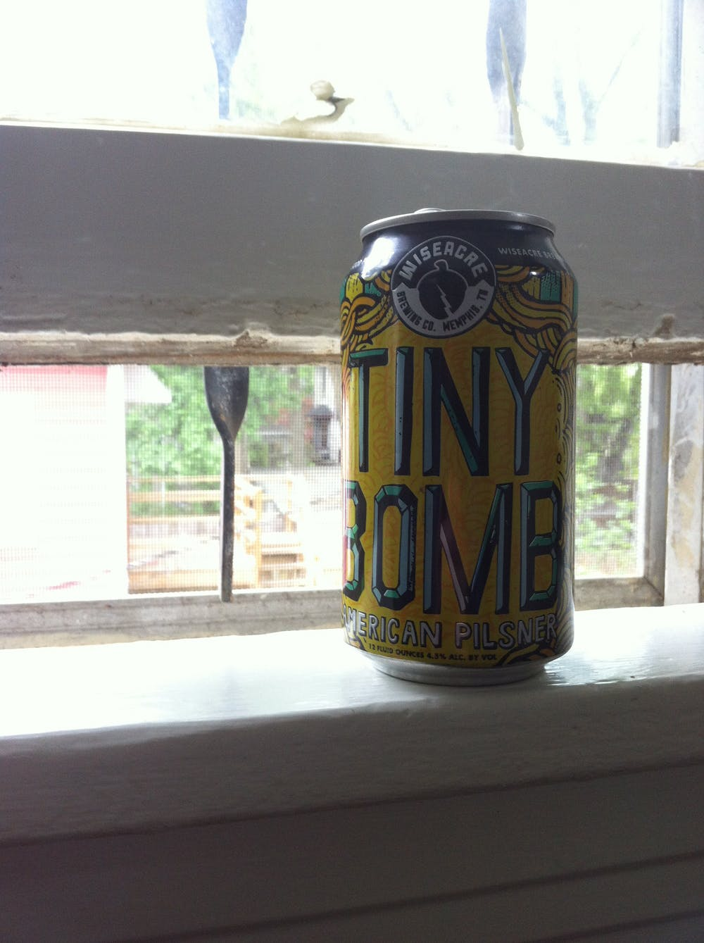 Close-up photo of a beer can with the words Tiny Bomb displayed across the front