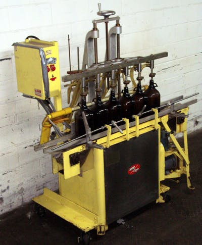 MRM Model MR-6-SPT 6-Head Vacuum Filler Bottle filler sold by Union Standard Equipment Co