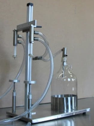 Benchtop Vacuum Filler - Bottle filler sold by TurboFil Packaging Machines
