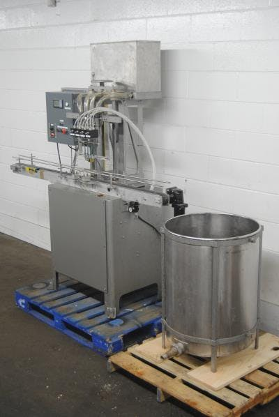 4-head stainless steel Liquid Fille Bottle filler sold by Union Standard Equipment Co