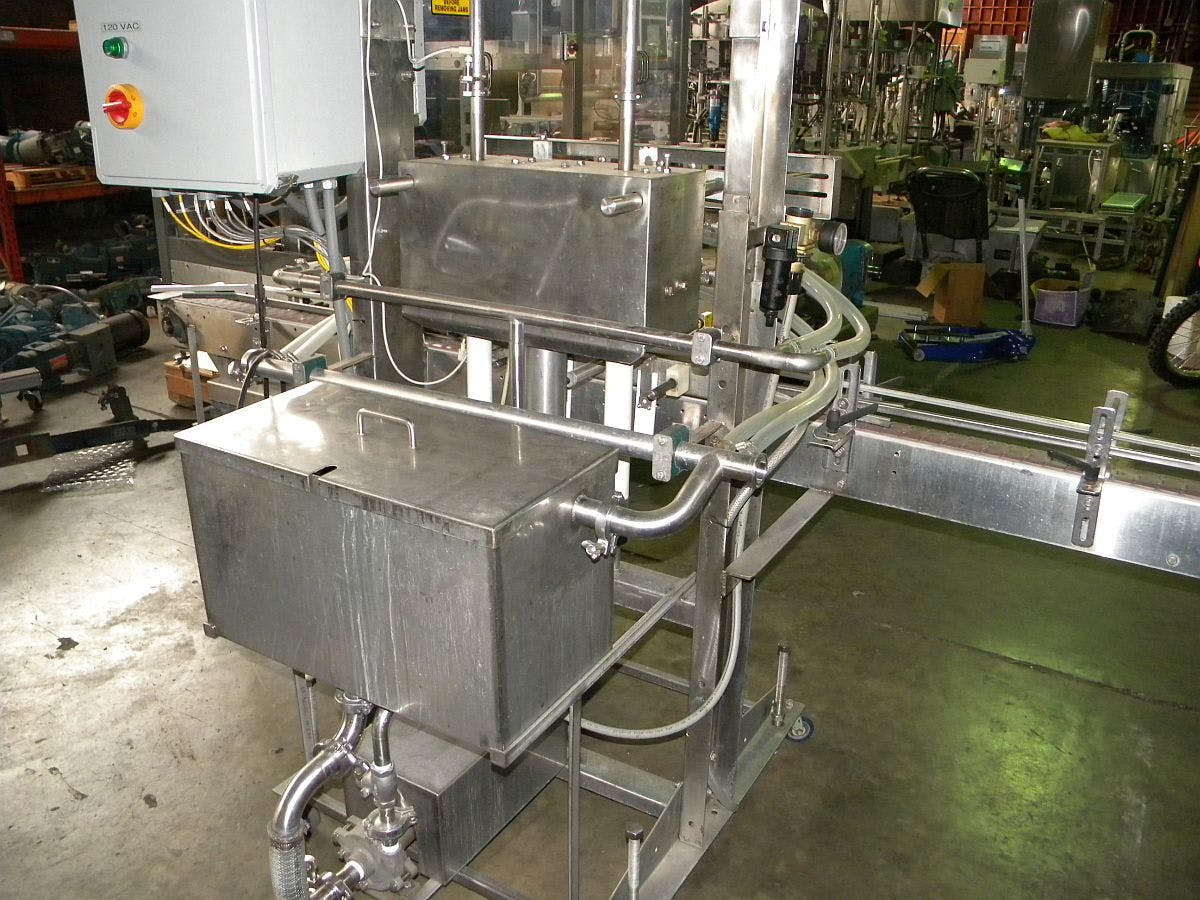 4 head inline filler for distillery use - sold by Ager Tank & Equipment Co.