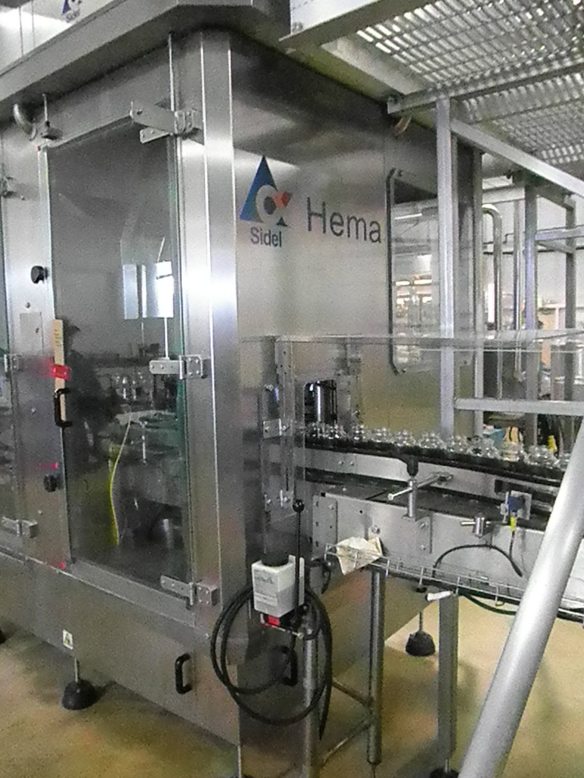 Used Sidel HEMA EV12 sanitary filling & capping monbloc system with CIP. Bottle filler sold by Machinery & Equipment Co