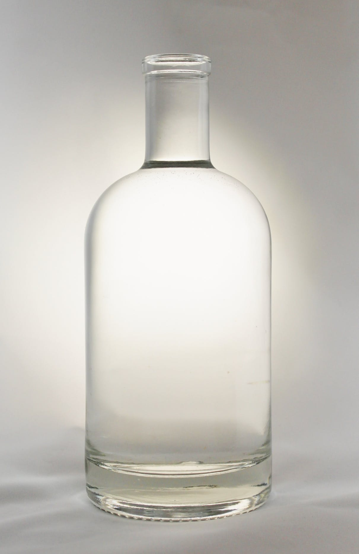 750 ml Nordic Round Bar Top Liquor bottle sold by Wm. R. Hill & Company
