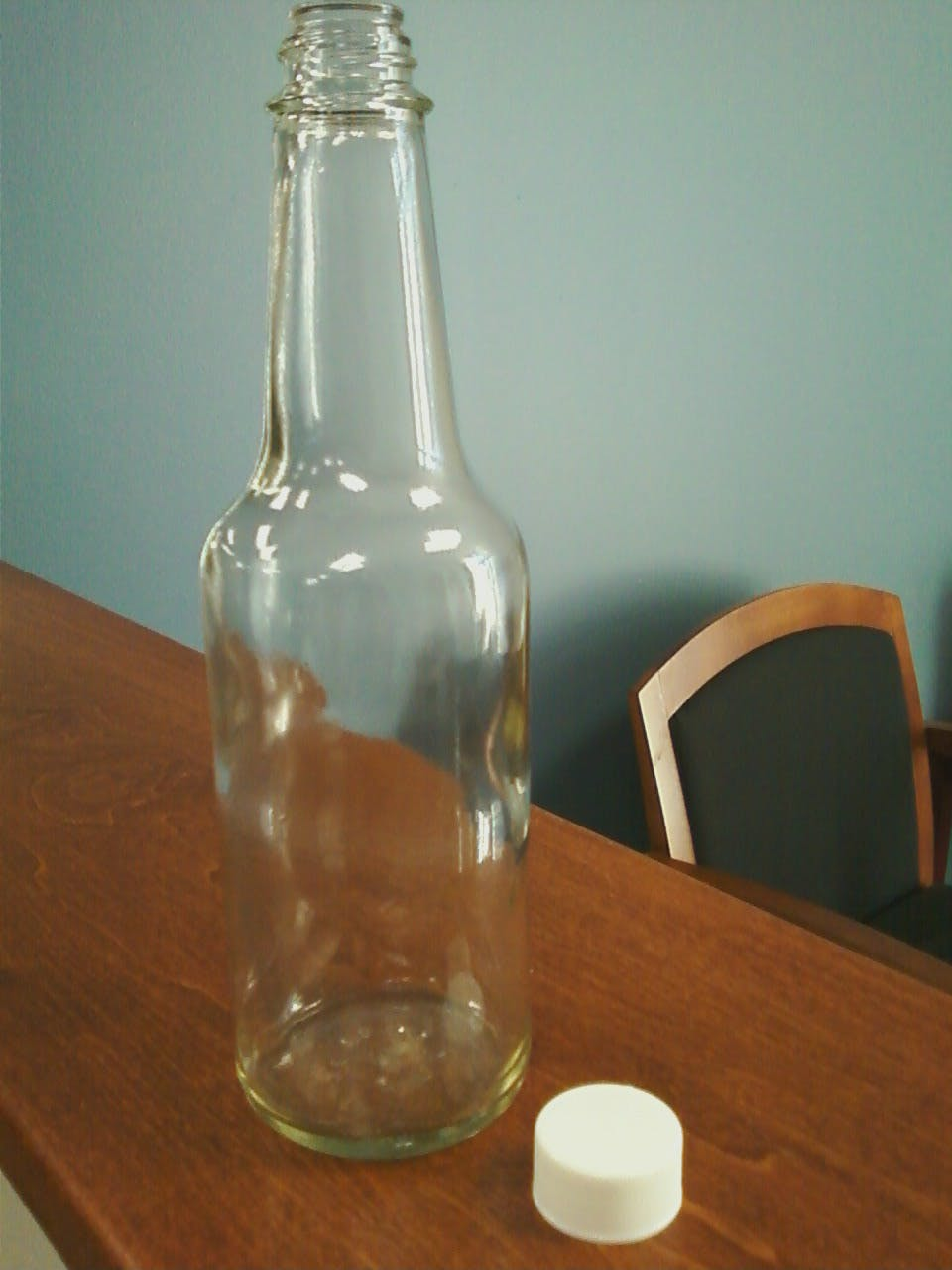 10 oz woozie glass bottle Glass bottle sold by Inmark Packaging