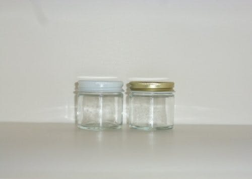 Straight sided glass jars with white or gold metal caps Glass Jar sold by Cape Bottle Company, Inc.