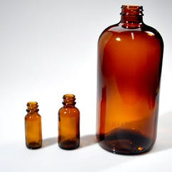 2 oz. Amber Boston Round Glass (#223437) Glass bottle sold by Berlin Packaging