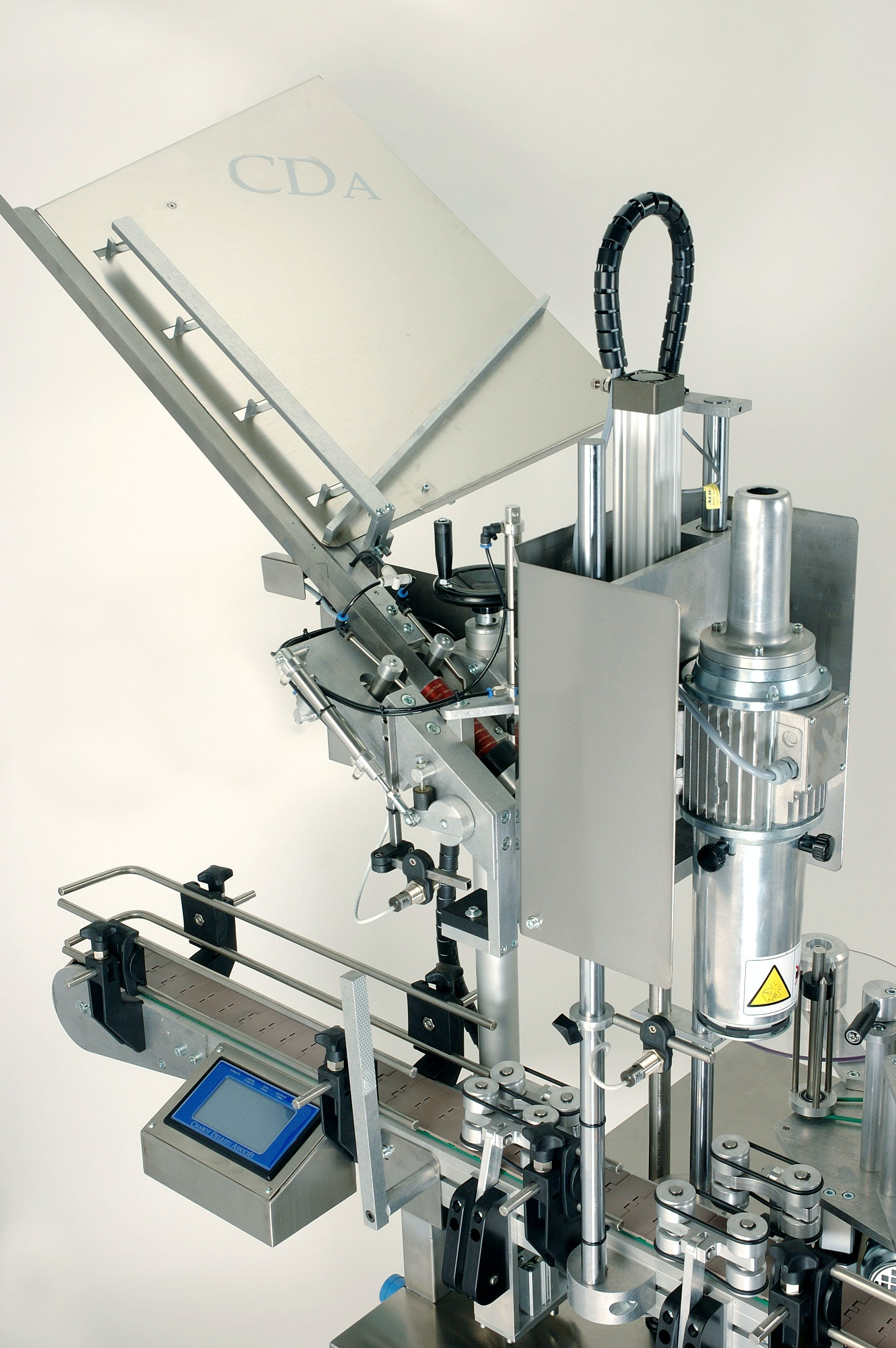 Cap System Packaging equipment sold by CDA USA Inc,