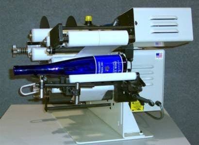 Semi-Automatic Round Product Label Applicator Bottle labeler sold by Neumann Packaging