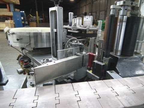 Used Hartland Mercury Inline Pressure Sensitive Labeler Bottle labeler sold by Sigma Packaging