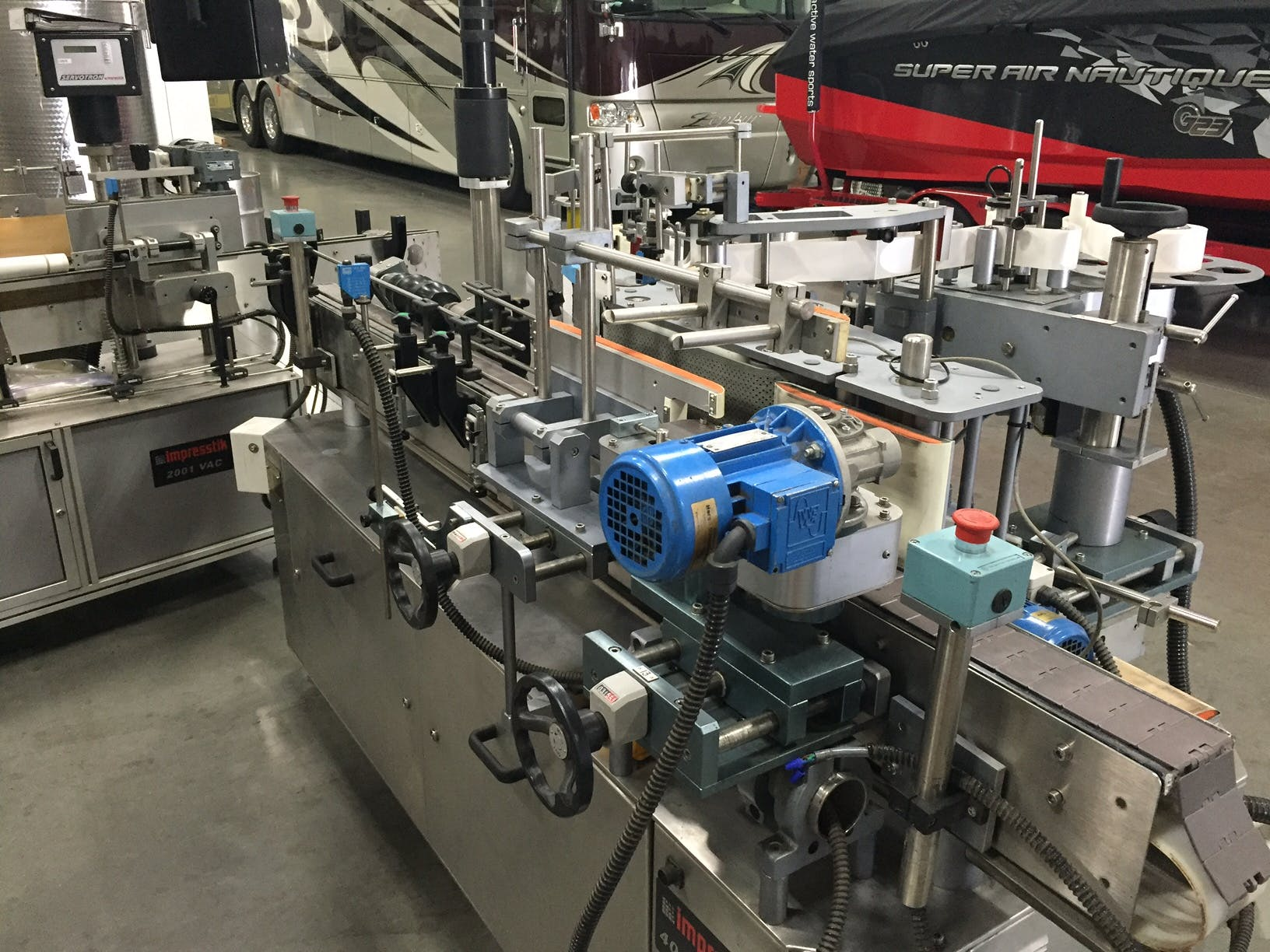 Impresstik Labeling Machine Bottle labeler sold by Scholz & Associates / Great Engineering