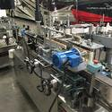 Impresstik Labeling Machine - Bottle labeler sold by Scholz & Associates / Great Engineering