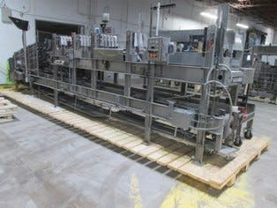 Hartness Model 2600 Continuous Motion Case Packer  Case packer sold by Beverage Industries