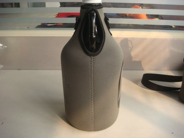 64 oz groozie  Bottle carrier sold by Booker Promotions Inc.