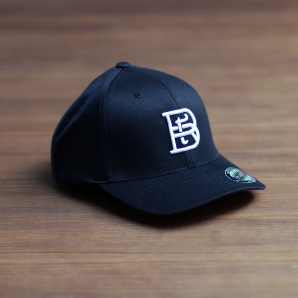 FlexFit 6277 - pre-curved bill (3D embroidery) Promotional cap sold by Brewery Outfitters