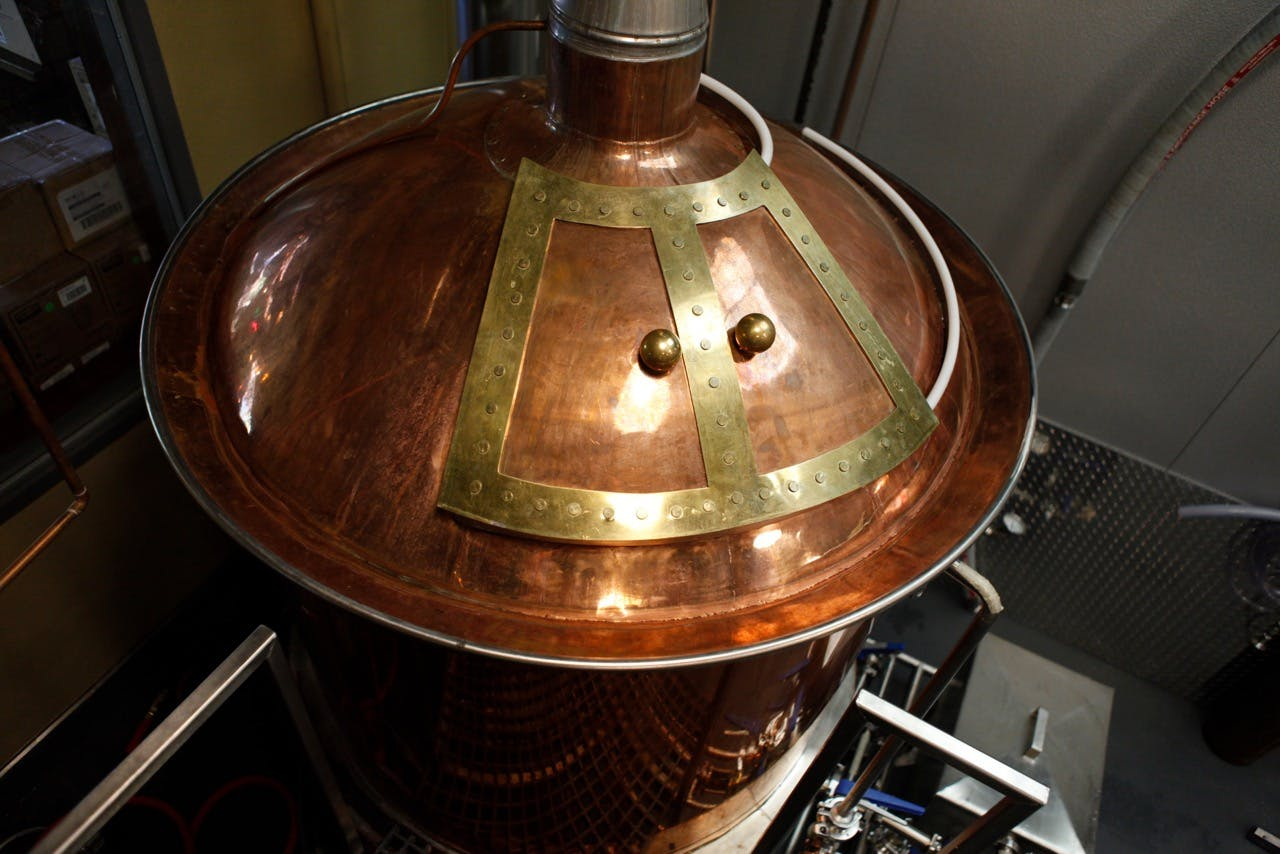 100% hand hammered solid copper tops Distillation still sold by Global Stainless Systems Inc.