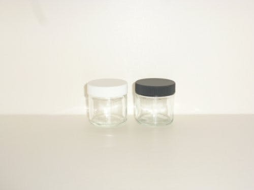Straight sided glass jars with black or white plastic caps Glass Jar sold by Cape Bottle Company, Inc.