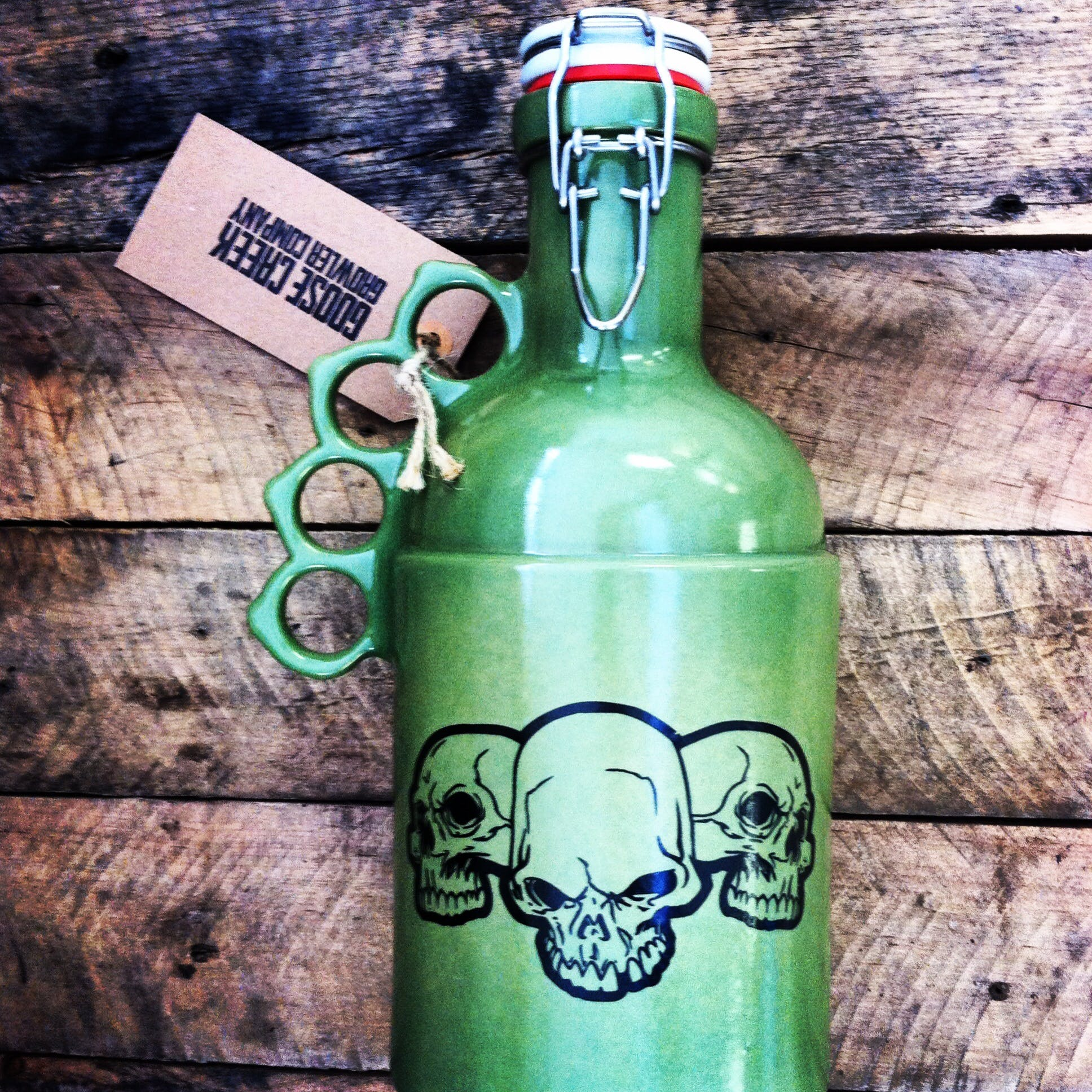 """Peacemaker in green with a custom skull image - """"The Peacemaker"""" - sold by Goose Creek Growler Co."""