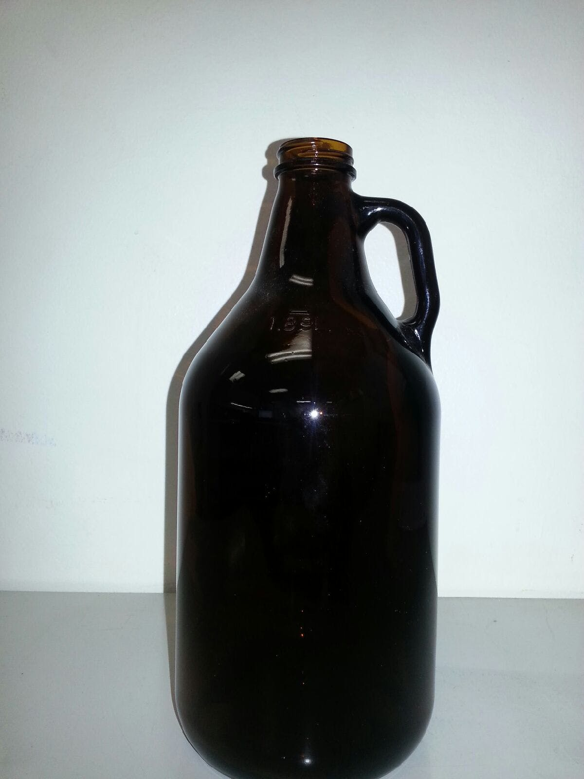 32 oz amber beer growler with screw top Growler sold by Bottle Solutions