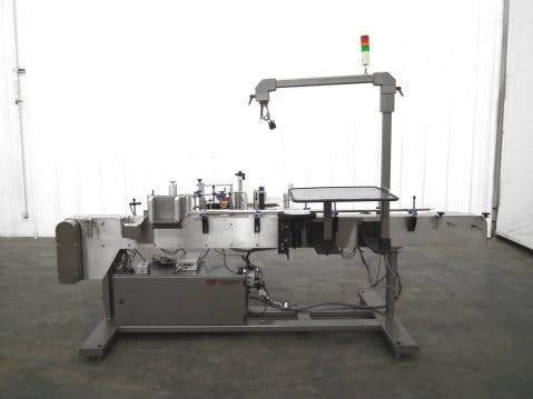 Used CapPlus Tech Wrap-Around PS Labeler - sold by Sigma Packaging