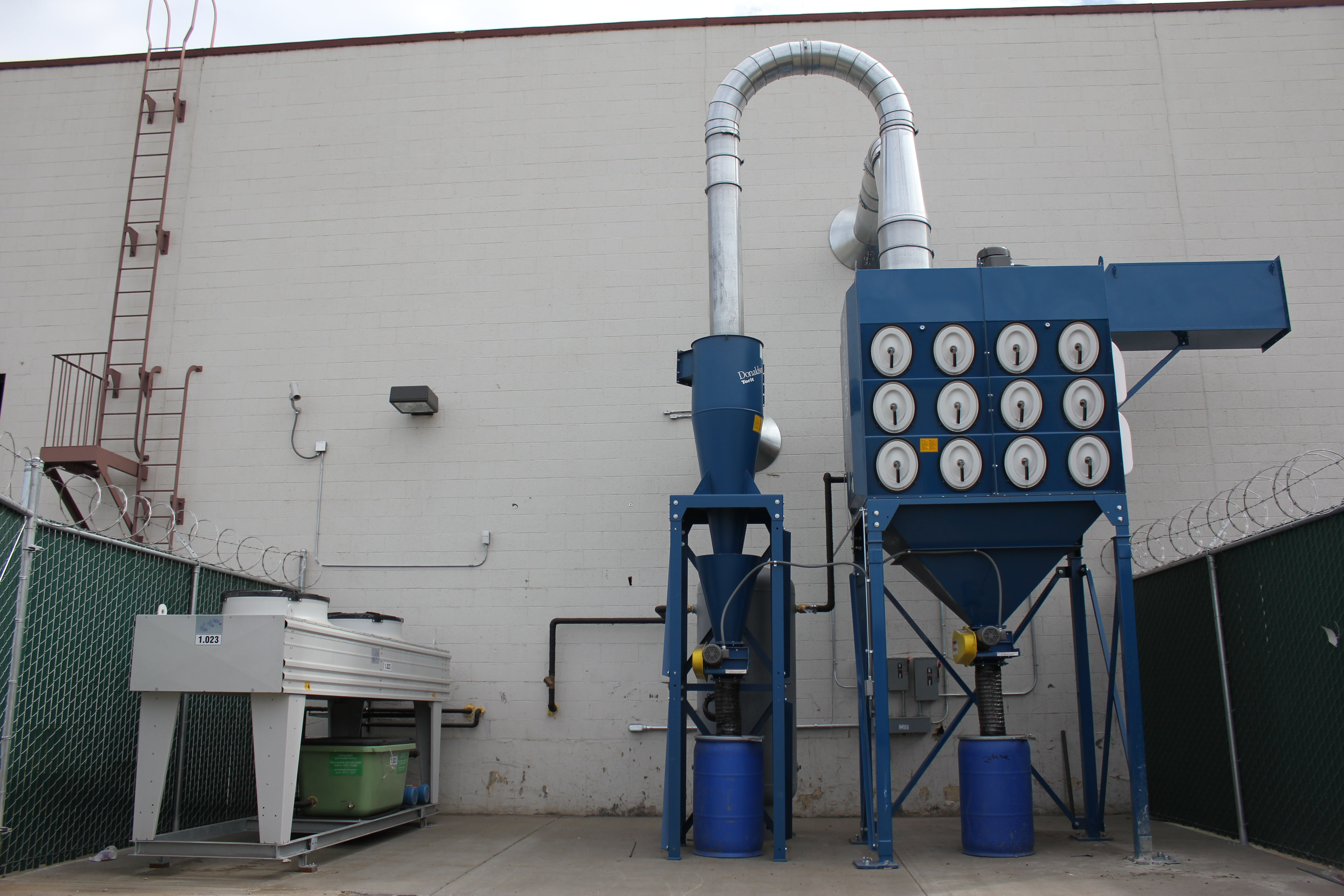 Cyclone pre-cleaner prior to dust collector.