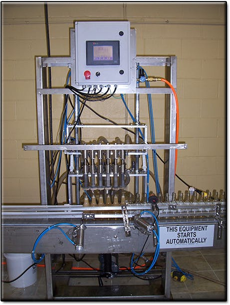 6 Head Overflow Filling Machine Bottle filler sold by Neumann Packaging