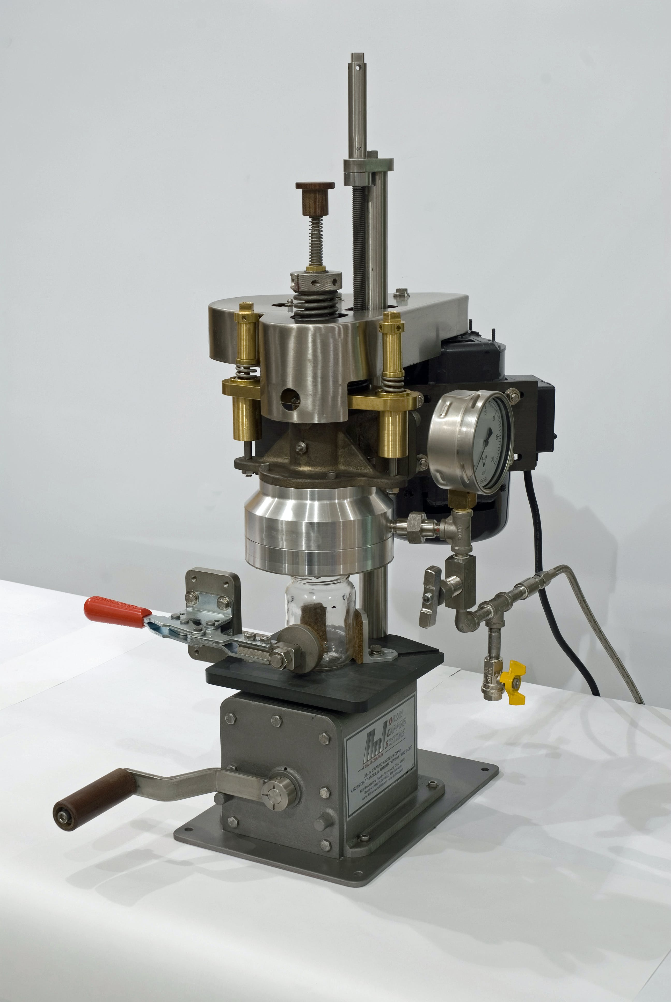 59-Series Single Head Steam Capper Bottle capper sold by Dillin Automation Systems
