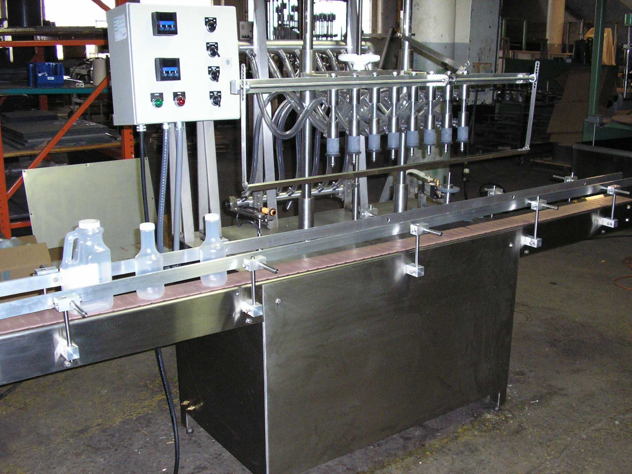 Fillrite 8 head pressure Gravity Filler NEW Bottle filler sold by T&T Machinery INc