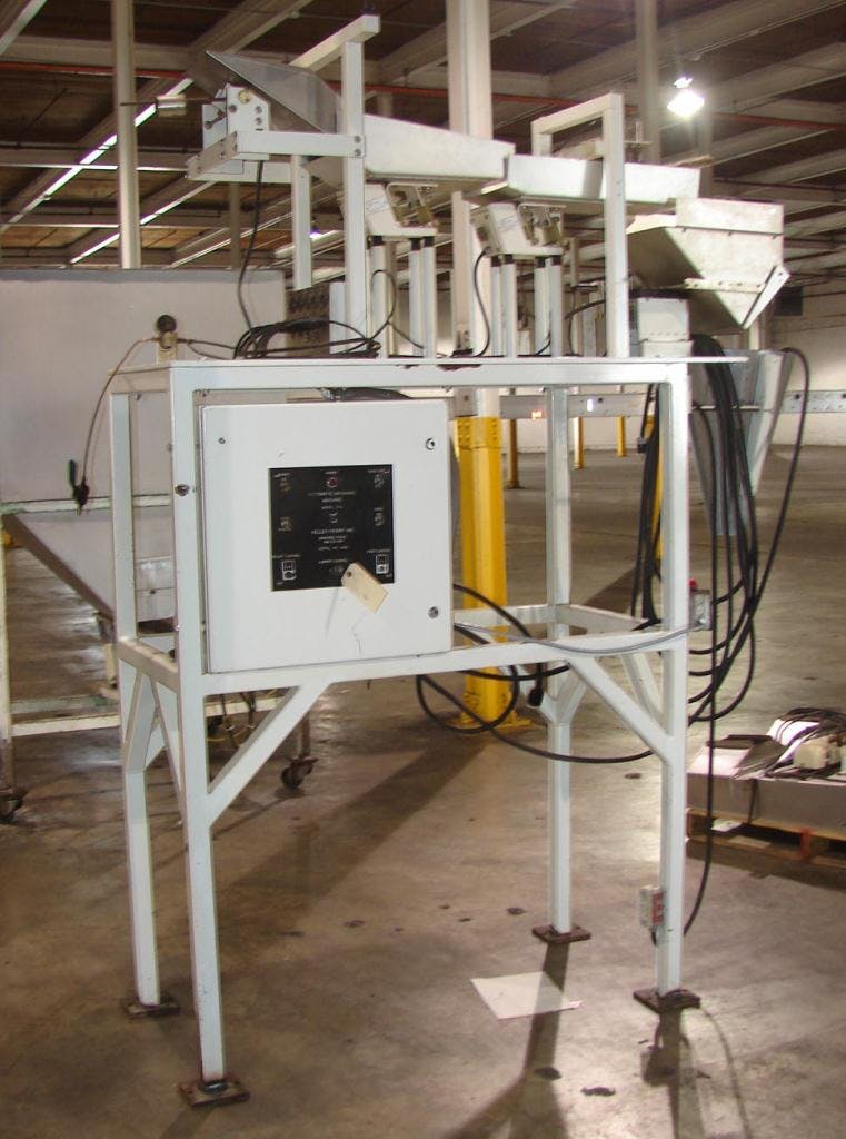 Kelly Perry semi auotmatic bag filler with vibratory scale feeders Net weight filler sold by Special Projects International
