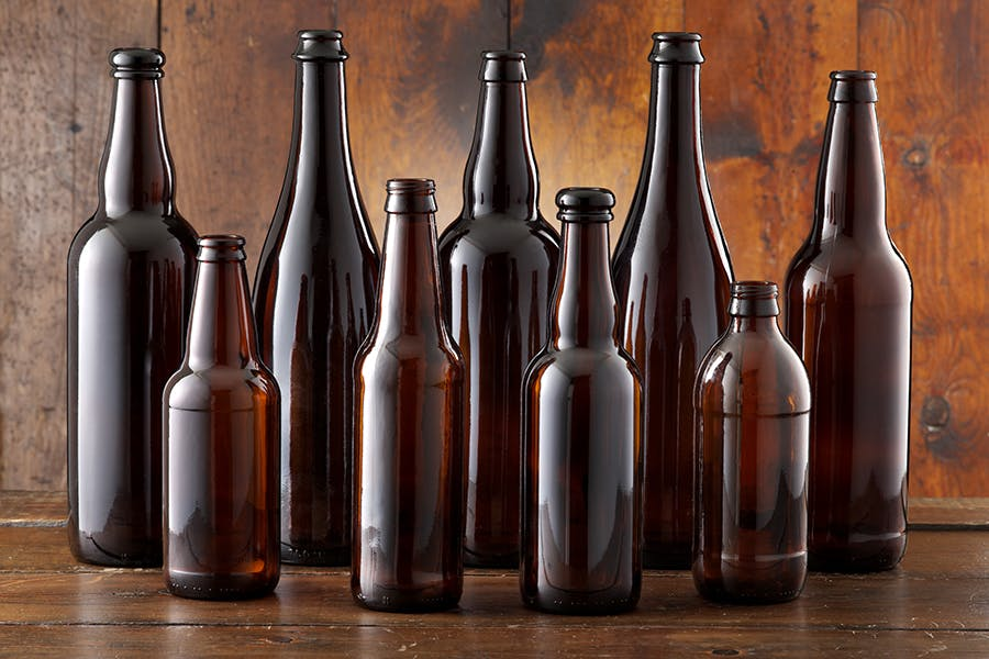 Amber Stock Bottles Beer bottle sold by Gamer Packaging Inc.