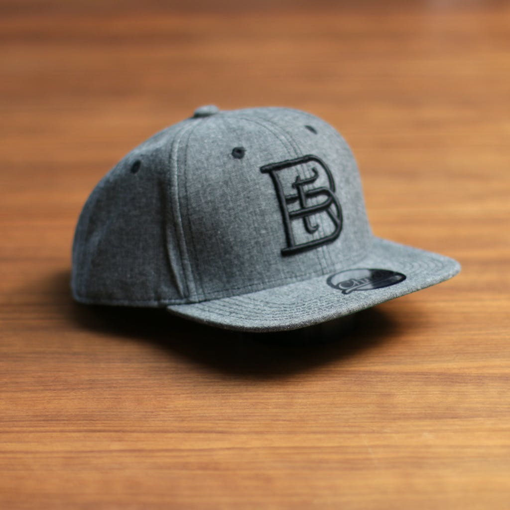 Chambray flatbill snapback (3D embroidery) Promotional cap sold by Brewery Outfitters