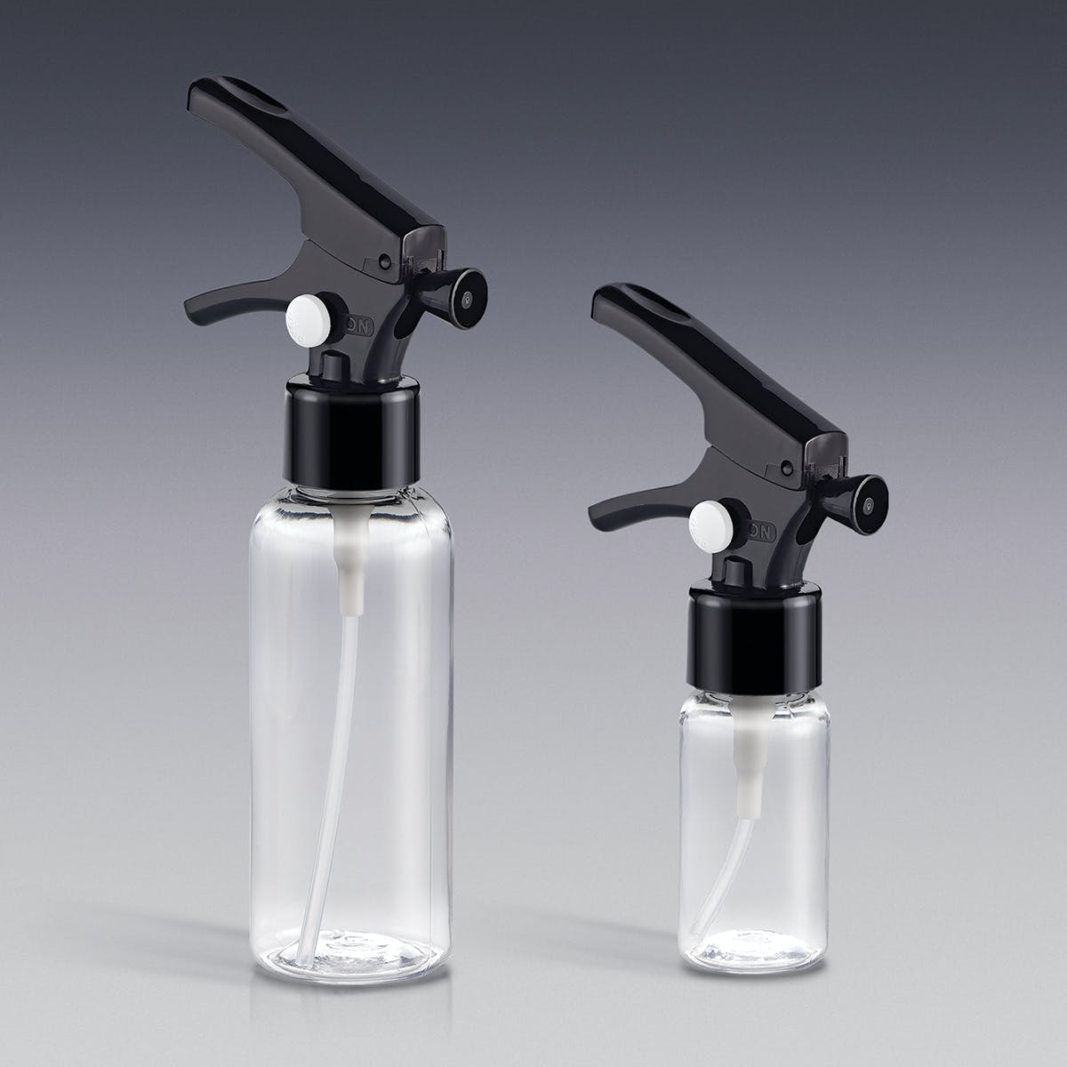 Mini Clear Bottles with Locking Trigger Sprayers Plastic bottle sold by Qosmedix