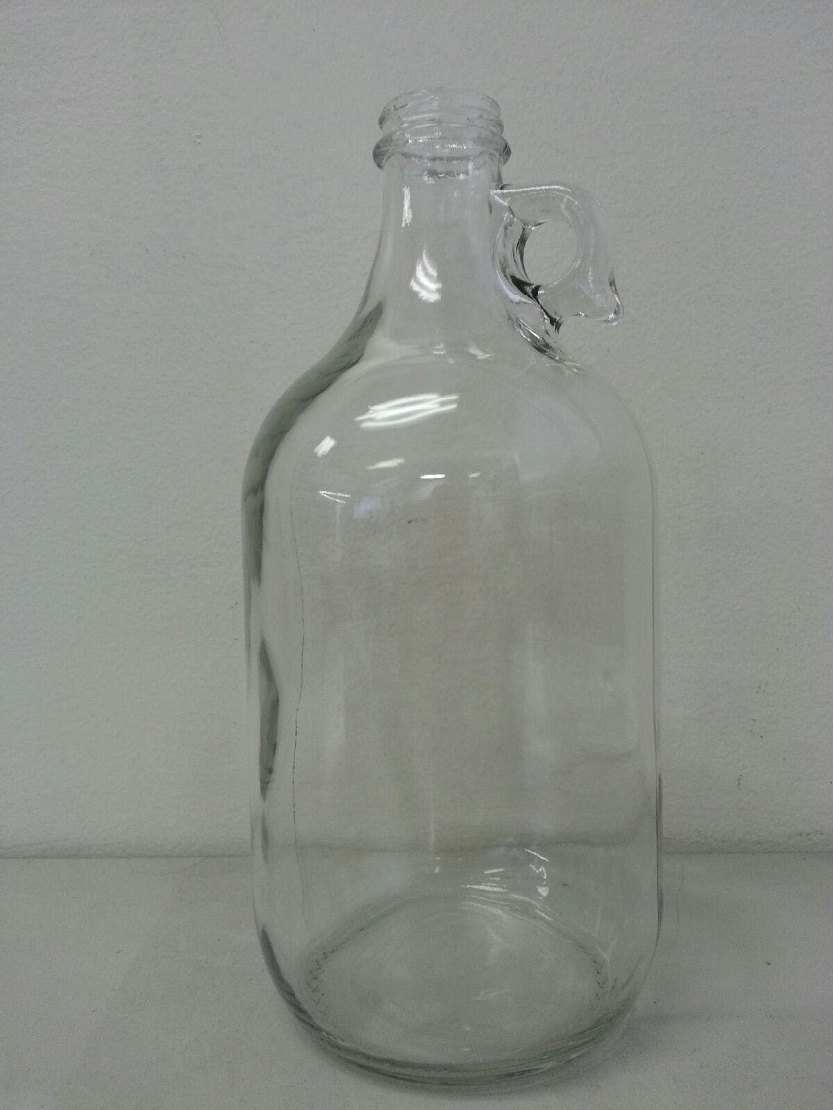 1 gallon or 64 oz clear or flint growler with screw cap Growler sold by Bottle Solutions