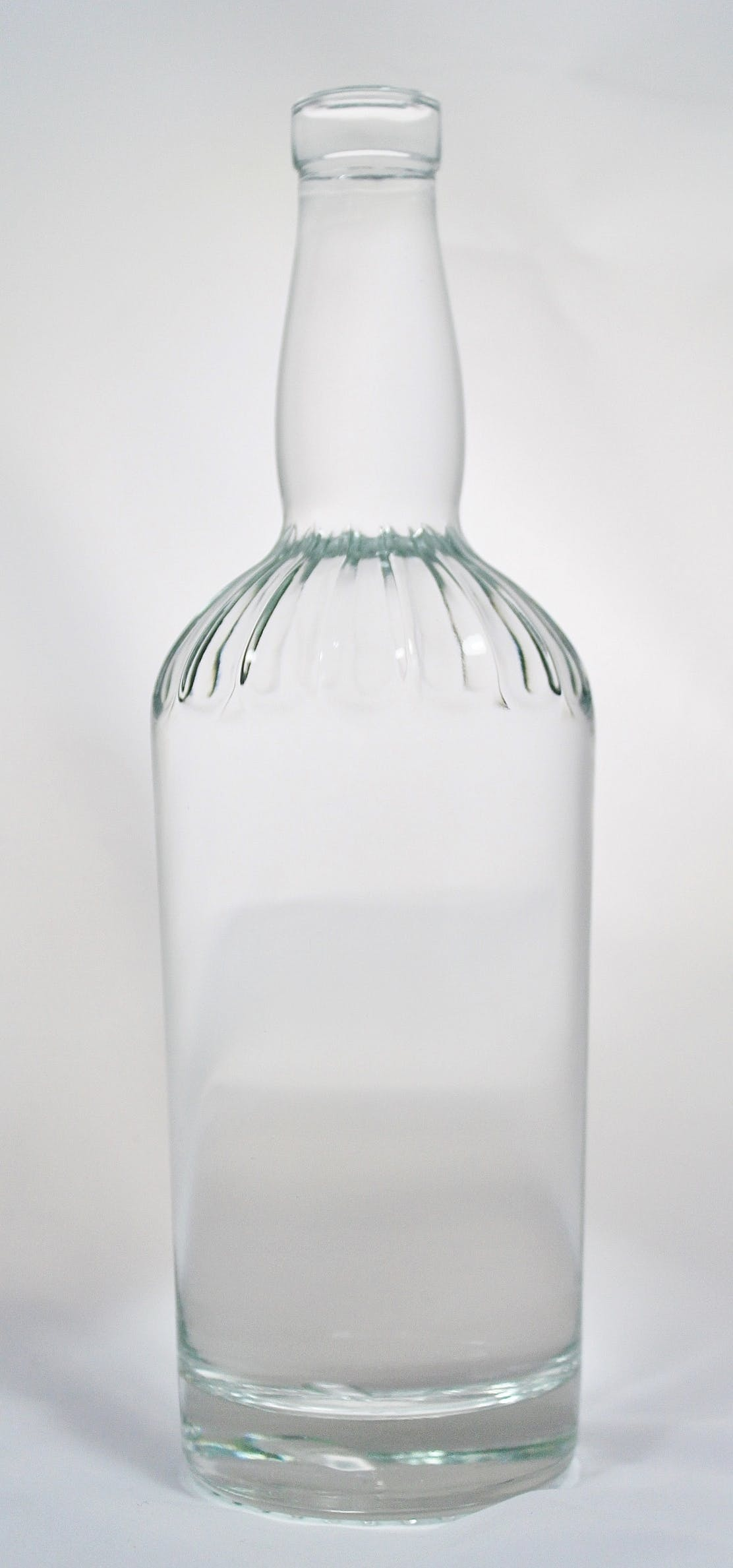 750ml Jimmy Lee Round Bar Top Liquor bottle sold by Wm. R. Hill & Company