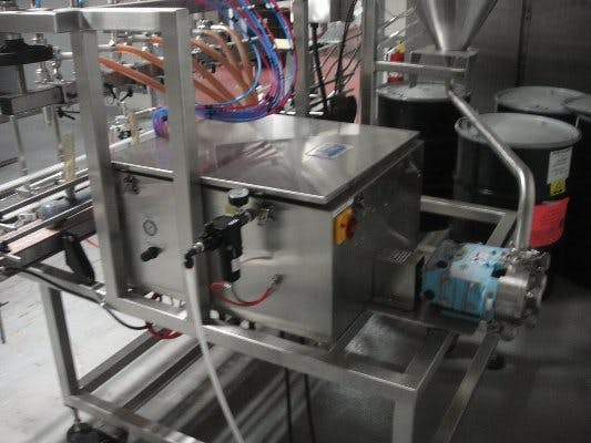 Oden 6-head pressure filler with Sure-Kap Capper Filling machine sold by Union Standard Equipment Co