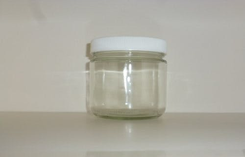 Straight sided glass jars with white plastic caps Glass Jar sold by Cape Bottle Company, Inc.