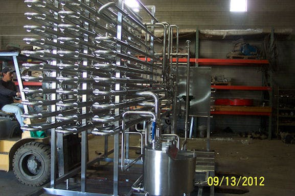 New Tubular HTST Continious Flow Pasteurizer for juice or thick product. Pasteurizer sold by Schier Company, Inc.