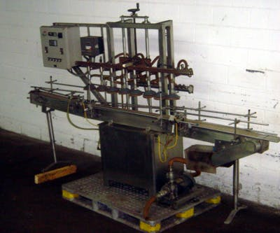 PACKAGING DYNAMICS SLA-12 8-HED STRAITLNE FIL Filling machine sold by Union Standard Equipment Co
