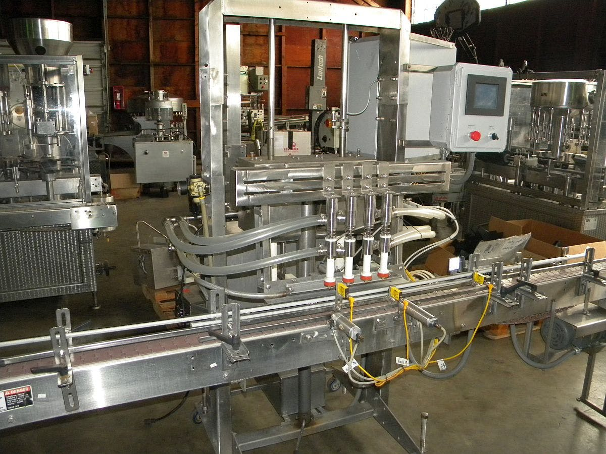 4 head inline filler for distillery use Bottle filler sold by Ager Tank & Equipment Co.