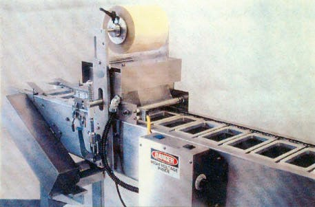 Continuous Motion Tray Sealing System Tray sealer sold by Performance Manufacturing / Packaging Systems LLC