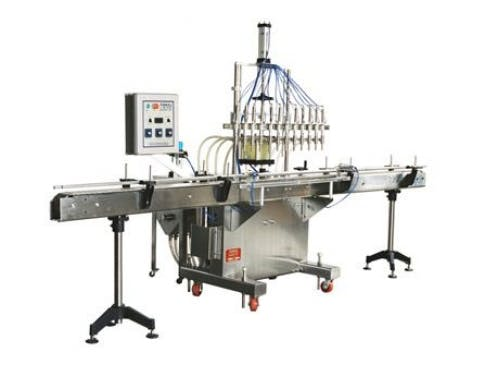 Piston Bottle Filler Model PI 3100 Bottle filler sold by ACASI Machinery