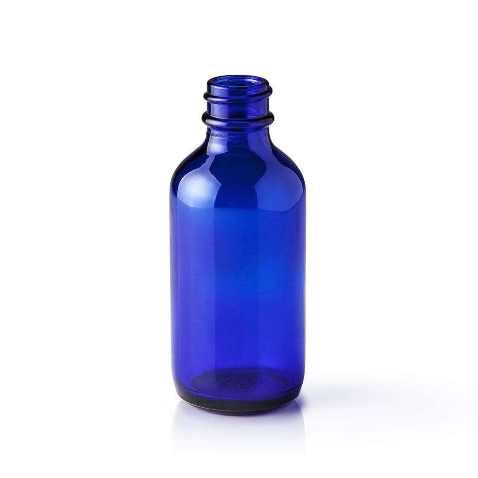 2 oz Cobalt Blue Glass Boston Round Bottle Glass bottle sold by Packaging Options Direct
