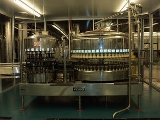 Fogg 56 Valve FIller with 20 Head Capper  Bottle filler sold by Beverage Industries