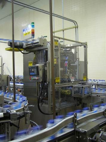 PDC R300 Stretch Sleeve Labeler with Dry Heat Tunnel and Label Unwinds w/Splice, Year 2007  Labeling machine sold by Beverage Industries