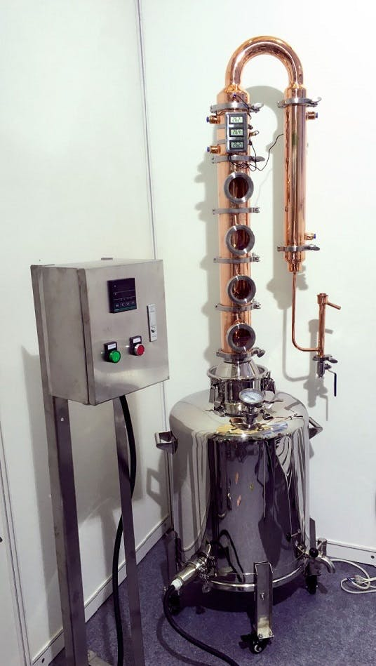 Olympic 4 inch Copper Flute Still – 4 Sections with 26 gallon (100L) Boiler Distillation still sold by Olympic Distillers