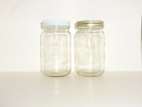 Economy glass jars with white or gold metal caps - sold by Cape Bottle Company, Inc.